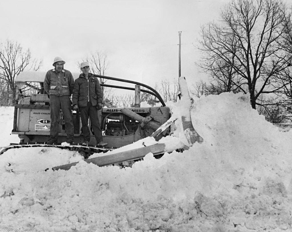 Mac Weems (right) and Arkansas Department of Transportation Foreman (left) near Eureka Springs on March 12, 1968 (Photograph by Joe Parkhill)